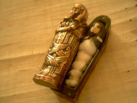 Egyptian mummy in coffin by Yowafan