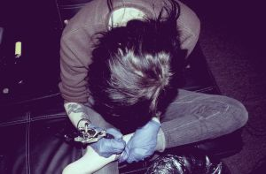 Tattooing my ankle by batty-boy