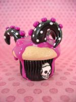 Black n Pink Tentacle Cupcake by monsterkookies