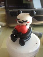 fimo panda with heart by magicalyuki