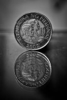 a coin, always, has two faces. by epsilon41