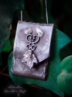 dawn shores leather necklace-wallet by Gwillieth