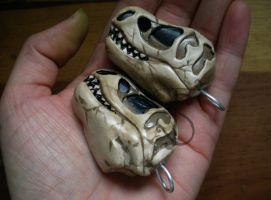 T-rex pendant made with fimo clay by sleepyhamsteri