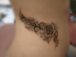 Tribal roses on side belly by ravenwarlock