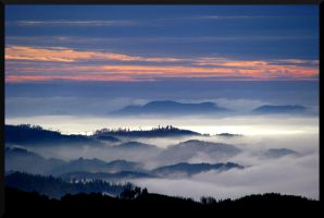 mist between the hills by giko296