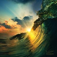 Sunset on the beach with surfing ocean wave by Vitaly-Sokol