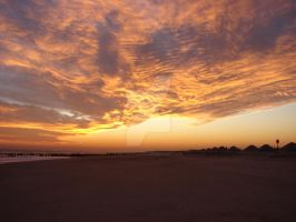 Clouds and sunset over beach by ArtieWallace