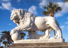 Lion Statue on blue sky by paintresseye