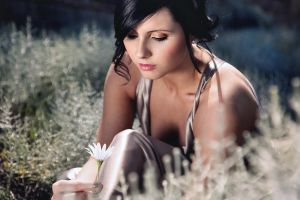 kirsty with a flower by fae-photography