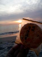 Had a snack while watching the sunset by Tokiarika