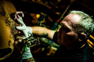 A weathered tattoo artist by dennissloan21