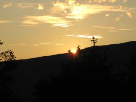 sunset in the mountains 2 by Charon1