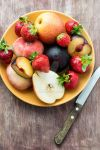 Fresh summer fruits in plate by BeKaphoto