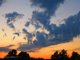 Clouds Against Orange Sunset by Michies-Photographyy