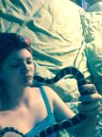Snake whisperer by DominaMoon