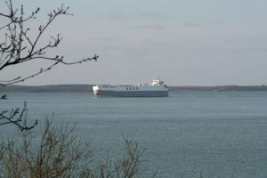 Outbound Cargo Ship by tammyins