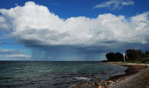 Distant showers at Baltic Sea by jchanders