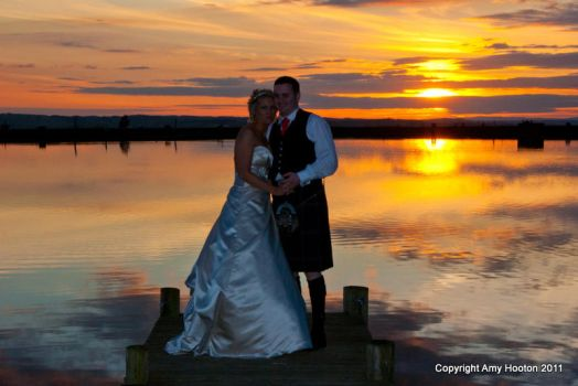 Sunset wedding couple by amyhooton