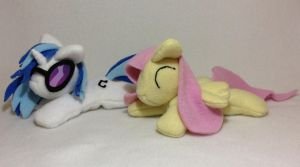 Vinyl Scratch and Fluttershy beanie plushies by Bewareofkitty