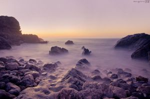 Misty sunset by MarioGuti