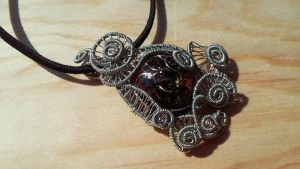 Handmade Silver wire wrapped resin pendant with ju by TheTwistedIngot