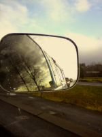 Truck in mirror in window. by Numain