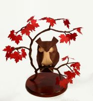 Origami owl in a maple tree by Haardod