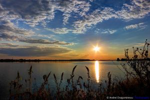 Sunset over Ciurel Lake by DrAndrei