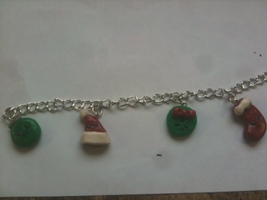 Christmas charm bracelet by muffinthehamster11