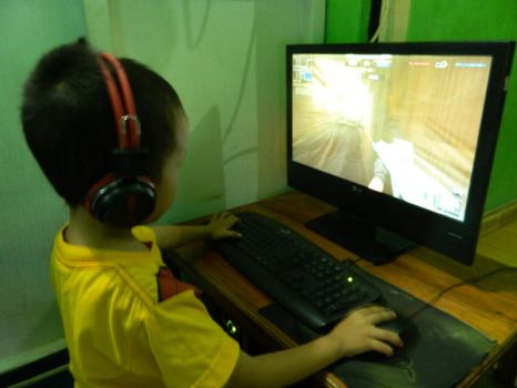 Children Playing Online Games by ngasih