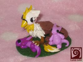 griffin with plush dragons by Luna-cuteXD