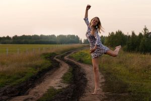 young girl dancing happy in a field by camaliaXcarmen