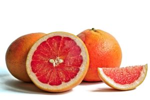 Red Grapefruits on a White Background by ReneLeBeau
