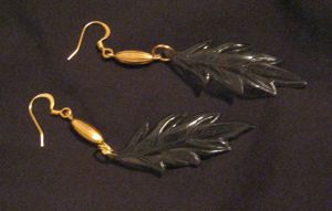 gold and green leaf earrings by Galasdian