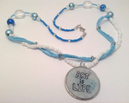 Art is Life blue and white beaded resin necklace by ArtAgainstSociety