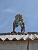Working on our roof. Sri Lanka by jennystokes