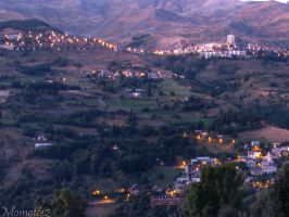 Evening lights on mountains by Momotte2