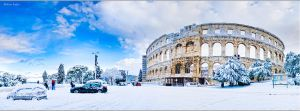 Amfiteatar covered with snow in Pula, Croatia by nrasic
