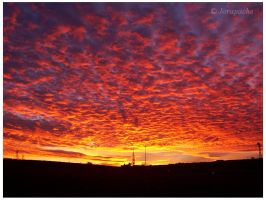 sunset with sky in flames by Jorapache