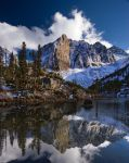 Reflection in a mountain lake by CheshirePhotographer