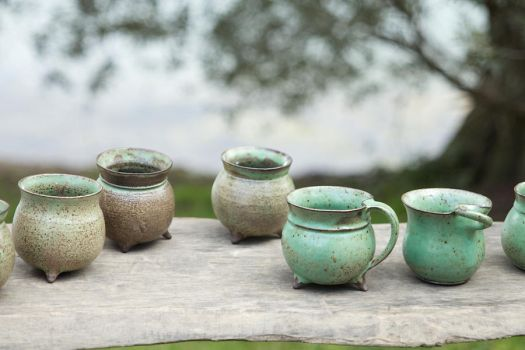 little green cups by Revelio