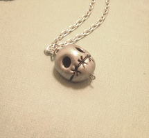 Stitched Skull Pendant by SweetButEvil