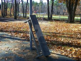 a bench leaning against a pole by krispykritta