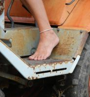Barefoot on tractor by Wire-man