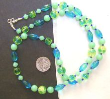 uranium-glass necklace 2: sun by wombat1138