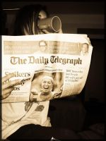 Reading daily Telegraph by LaMoccacino