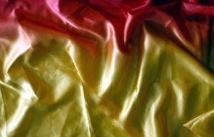 red and yellow satin fabric by beckas