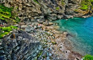 High tide at Tintagel beach by forgottenson1
