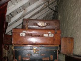 Suitcases in the attic by Gardek
