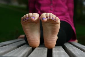Lilac toes expose by foot-portrait